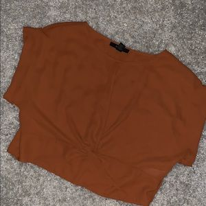 Orange knotted cropped top